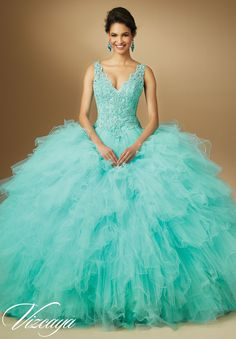 Quinceanera dresses by Vizcaya Crystal Beaded Lace on Ruffled Tulle Matching Stole. Available in Champagne, Coral, Aqua, White