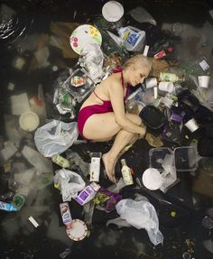 """We are all aware of the global pollution problem, but hardly anyone realizes just how much trash we produce daily. Gregg Segal, a photographer from California, aims to show this problem through powerful imagery, photographing people lying in their weekly load of trash. His ongoing project called """"7 Days of Garbage"""" tries to portray people from different social backgrounds to reach largest audience possible."""