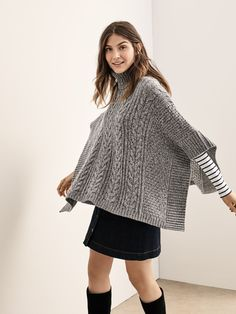 Looking for a cute poncho this Fall? Shop for this cable knit turtleneck poncho on gap.com. Exclusive colors available with a soft and cozy knit. This relaxed look is sure to fit into any wardrobe. Layer up in style and don't forget to accessorize.