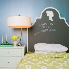 Really cute chalkboarded painted headboard with cameo on top!