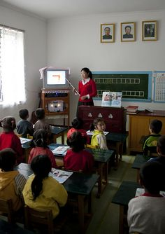North Korea: The Government makes sure that the education system maintains a basic structure. They do not want schools becoming over populated so they move kids between schools so schools stay clean and have a nice environment for all to learn. Life In North Korea, Korea Country, Socialist State, Korean Peninsula, A Classroom, Education System, Schools, Activities For Kids, Contemporary Art