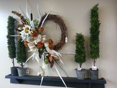 Rustic yet fabulous wreath with natural colors, feathers and antlers. Another beautful custom design from Stauffers of Kissel Hill Garden Centers. www.skh.com
