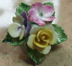 A posy of flowers in bone china. Make this pretty vintage brooch. Sold
