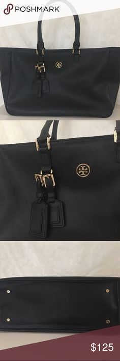 Tory Burch Roslyn Tote Excellent condition authentic Tory Burch Roslyn tote in black coated canvas. This is a large bag. Would be great for school or work also. Only flaw is some of the plastic seal along the trim of the straps has come off. Very minor.   Measures 16 inches across (not including sides that stick out) and 11 inches in height. Has a base width of 5 inches and a strap drop of 7.5 inches. Tory Burch Bags Totes