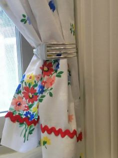 Clever idea for a tie back the curtains from vintage table cloths