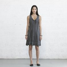 The beautiful Grey color sundress features: Pleads on the front and back, Placket all the way down to the button of the dress. A waistband that accentuate a waist-line thus create a more feminine shape, very playful. Sides packets. .  comes in 2 sizes   Fabric cotton rayon . regular machine wash . Air dry .