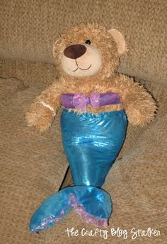 Sew  a mermaid costume for your favorite stuffed bear. Follow this easy pattern and instructions and your build a bear will be swimming in no time.