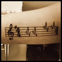 charlesphoenix:  thecaits-meow:  New tattoo(:  TATOO twins! Mine only has one heartbeat, but i picked the key of F, and i did the common time C. The repeat sign is the most important part.  Thank GOD someone took this awesome design and made it musically correct. KUDOS.