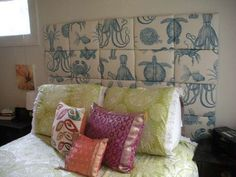 Love the headboard idea, hate the fabric. But a nice black and white pattern would be awesome...