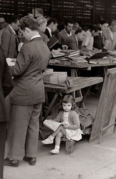 little girl reading at a book sale? For more book fun, follow us on Pinterest & Facebook. www.facebook.com/booktasticfun
