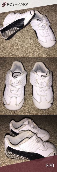 Unique Puma Sneakers size 5 White & Black So Cute! Unique Puma Sneakers size 5 White & Black So Cute! Double adjustable Velcro on each side of each shoe for perfect fit. Kinder Fit insole for measuring and comfort. Adorable design on sides of each shoe. Perfect first walker shoe. Great Condition! Puma Shoes Sneakers