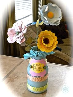 """for the current @Spotted Canary challenge. I made these little paper flowers and a """"vase"""" from an old bottle. More details are on my blog at: http://noelle-paperandice.blogspot.com/2012/02/handmade-paper-flowers-in-recycled-vase.html"""