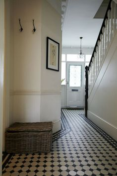 black and white foyer tile | Edwardian house foyer with original black and white tiled floors