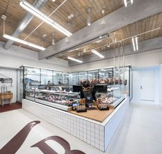 Two Rivers Meats Vancouver Restaurants, Wood Grill, Meat Shop, Two Rivers, Restaurant Concept, Shop Fittings, Terrazzo Flooring, Street House, Cool Apartments