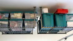 I think these overhead storage for garage are really nice.  DIY: How I Organize My Seasonal Decor