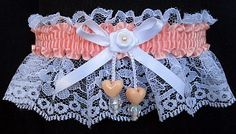 You are Fashion Forward with this white lace Garter with CORAL ICE satin band and matching double hearts. Garters for Wedding - Bridal - Prom - Fashion. Style # FM-2AN-205 / Visit: www.garters.com/page13a.htm