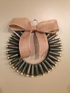 12 inch olive green shotgun shell wreath with a burlap bow! Perfect for the hunter in your life. Please let me know if youd like a custom order.