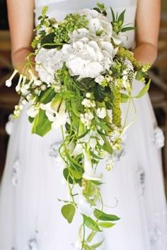 Custom-designed for a French fairy tale wedding.  White hydrangeas, trailing snowberries, delphiniums, green amaranthus, and passion-flower foliage!    12 Absolutely Gorgeous# Cascading #Wedding #Bouquets
