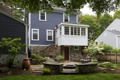"""This Arlington, MA kitchen expansion features a cantilevered 9'9"""" addition overlooking the beautifully landscaped yard."""