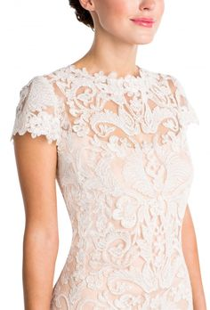 A short lace dress with ivory lace over a petal sheath and cap sleeves for wedding looks. Affordable designer bridesmaid dresses to buy or rent at Vow To Be Chic.