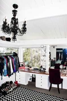 Fabulous Bedroom Converted Into Closet With White Wood Paneled Ceiling  Accented With Glossy Black Chandelier As