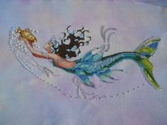 Love how Joyce's came out!     Mirabilia, Mediterrean Mermaid on Crafty Kitten Daybreak - stitched by Joycelyn.