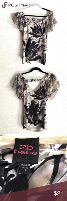 Cute 2be bebe Top ✨Very cute & stretchy fabric 2be bebe top! It has very cute sheer material on sleeves, open V back neckline! (Love the detail of back for covering bra line) the print is leopard/floral ✨very excellent condition bebe Tops