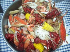 Low country boil-  crawfish, blue crab (whole) snow crab legs, shrimp, mussels, corn on the cob, kielbasa, red potatoes & some lemons (cut into halves). Boiled in water, beer & Old Bay seasoning.