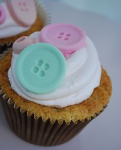 """Passion 4 baking """"Vanilla cupcakes with something sweet in the middle(piece of chocolate, caramel or whatever you like), meringue frosting & marzipan button"""