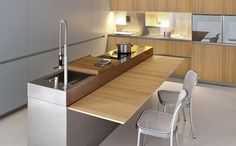 Slide out the serving area of the kitchen island only when needed