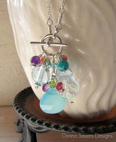 Pale Aqua Blue Toggle Necklace | Handmade glass beads float on a sterling silver toggle. Pale aqua glass beads including my signature leaf bead and bright semi precious gems for a pop of color. | Donna Sauers Designs