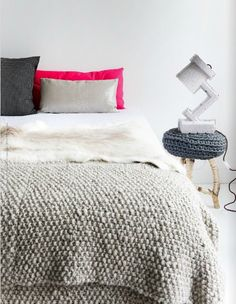 i love the idea of a white bedroom with a big comfy fluffy white bed and grey accents thrown about the room with little pops of color here and there.  i want to take naps in this imaginary bedroom in my head.