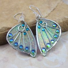 Sidhe Wings Earrings - Silver Experimental Wings in Blue Glitter. $ 44.00, from SihayaDesigns,   Handmade Artisan Jewelry by Christina Allen Page, Etsy.