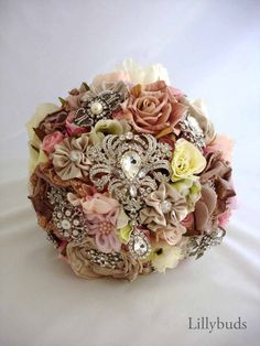 The Cottage Glamour Bouquet.  Prices start at $595.00AU  A very large, full rounded bouquet, befitting a romantic garden or shabby chic wedding.
