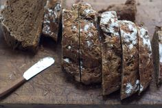 Black Bread - A hearty black bread - caraway-crusted, and flecked with dashes of grated carrot. It's dark, dense with rye, and perfect when toasted then topped with a fat smear of dill butter.  - from 101Cookbooks.com