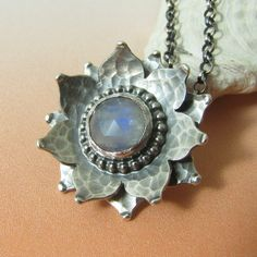 Sterling Silver Rainbow Moonstone Necklace, Lotus Necklace, Artisan Jewelry, Metalsmithed Argentium Necklace, Gemstone Jewelry, Lotus Flower by Mocahete on Etsy https://www.etsy.com/listing/130671799/sterling-silver-rainbow-moonstone