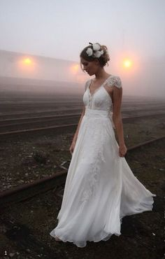 Wedding dress with capped sleeves, whimsical train and bow-tied back by Emannuelle Junqueira.