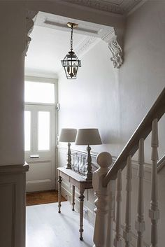 Entering into the narrow hallway, the palest of taupe paints above the dado rail, and a chalky, putty paint tone on the panelling below combine to set the tone for the whole house. Period details abound in this home....Full details on Modern Country Style blog: Swedish/French Style Victorian House Tour