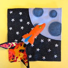 I have the first page of Jax's Quiet Book finished! This page was inspired by Handmade by Jill's rocket page and the fact that Jax's grandpa was a rocket scientist (astrophysicist.) I created a pat...