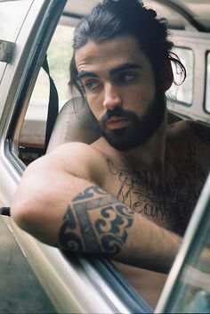 Tat's, Beard, and Hair. And yes, I drive around shirtless sometimes too, it is a thing.