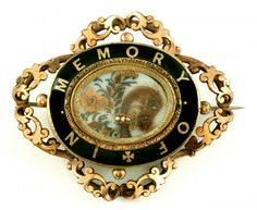 """Mourning brooch with palette worked hair in several styles (with some very pretty colors) and a black enamel framing that reads """"In Memory Of"""""""