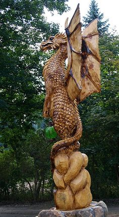 Chainsaw Carved Dragons | to be a Lake Orion dragon. He was carved entirely with a chainsaw ...
