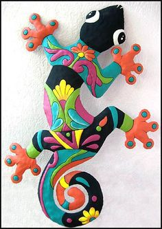 Metal art - Gecko, Painted Metal Gecko Garden Art - Haitian art, Tropical home decor, Garden Decor - Metal wall art Hand painted metal Gecko - Measures 12 x 18 This same gecko metal art wall hanging is available in 2 other sizes: Gecko - Outdoor Metal Wall Art, Metal Garden Art, Metal Wall Decor, Hanging Wall Art, Metal Art, Wall Art Decor, Wall Hangings, Art Tropical, Design Tropical