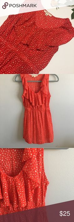 Red/orange colored and white polka dotted dress Red/orange flowy dress with white polka dots. Synched at the waist and has a ruffle along collar. This is the perfect ALL occasion dress! Never been worn or washed! Feel free to ask questions or make an offer! Dresses Mini