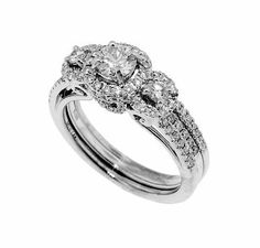 A 14k white gold and diamond semi-mount ring.  The engagement diamond is 0.60 carat total weight, sides plus round brilliant cut center diamond, 0.33 carat, with I/J color and VS1 clarity.  Band diamonds = 0.14 carat total weight.  Priced: $2,995.