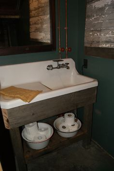 Original kitchen sink relocated to basement half bath. With custom vanity. MoXie Ladies, LLC.