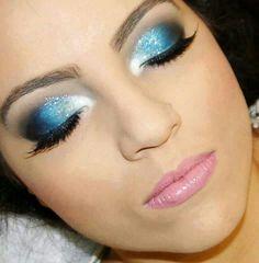 Sparkly blue eyeshadow &  pink lips.  Super pretty.