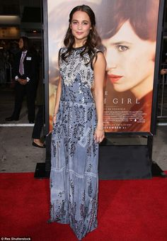 Dazzling in blue: Alicia Vikander's greyish-blue gown featured a detailed network of embro...