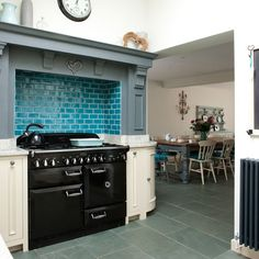Rangemaster Elan 110 range cooker in gloss black with a real splash of colour from the tiles