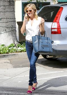 The fun never ends: Reese Witherspoon showed off her slender frame in high-waisted jeans as she chatted on her phone before treating herself to a manicure and pedicure at Bellacures nail salon in Brentwood, California on Tuesday